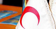 Флаг Национального общества Красного полумесяца, фото из архива