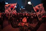 Сторонники президента Южной Кореи Пак Кын Хе вышли на демонстрацию в Сеуле, фото из архива