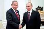 Президент РФ Владимир Путин и премьер-министр Израиля Биньямин Нетаньяху (слева) во время встречи