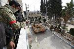 Бойцы ВС Турции и Сирийской освободительной армии в Африне, 18 марта 2018 года