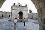 Атешгях — музей под открытым небом, храм вечного огня в Азербайджане, на Апшеронском полуострове, в 30 км от центра Баку, на окраине селения Сураханы. Атешгях в современном виде построен в 17—18-м веках