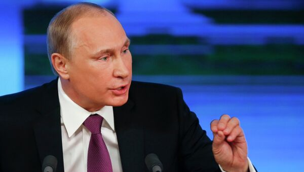 Russian President Vladimir Putin speaks during his annual end-of-year news conference in Moscow - Sputnik Azərbaycan