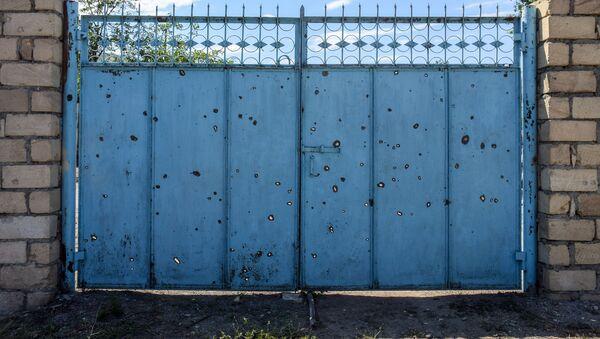 Поврежденный в результате обстрела ВС Армении дом жителя Товузского района, фото из архива - Sputnik Азербайджан