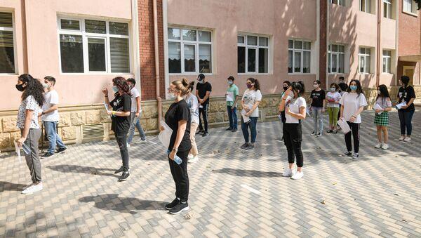 Вступительные экзамены в вузы по II и III группам специальностей - Sputnik Azərbaycan