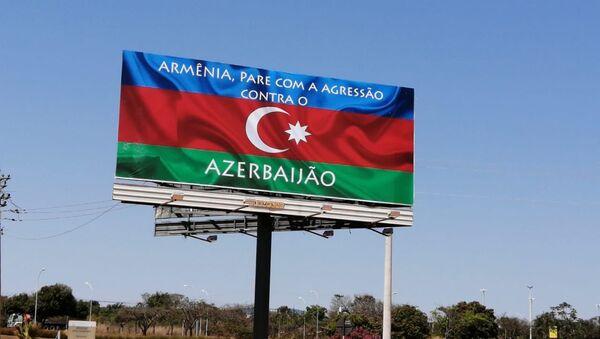 Билборд, информирующий об агрессии Армении против Азербайджана, в Бразилии - Sputnik Азербайджан