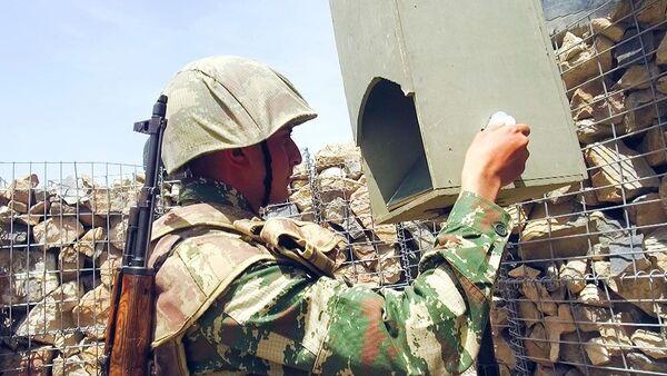 Азербайджанский военнослужащий на боевой позиции, фото из архива - Sputnik Азербайджан