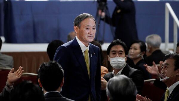 Лидер правящей в Японии Либерально-демократической партии (ЛДП) Ёсихидэ Суга, фото из архива - Sputnik Азербайджан