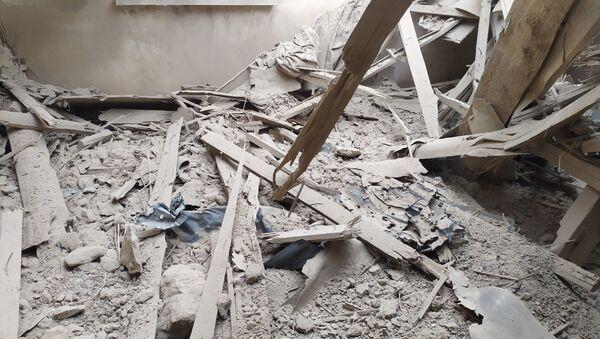 Последствия обстрелов в азербайджанском селе Учоглан близ Карабаха  - Sputnik Азербайджан