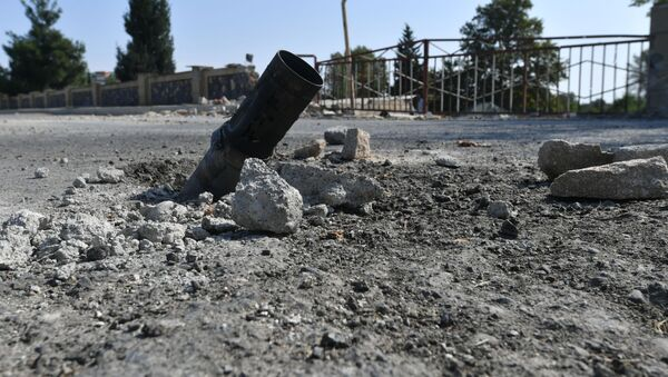 Снаряд системы залпового огня Град на дороге в азербайджанском Тертере близ Карабаха - Sputnik Азербайджан