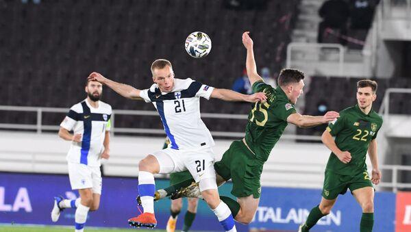 Игровой момент матча сборных Финляндии и Ирландии - Sputnik Азербайджан