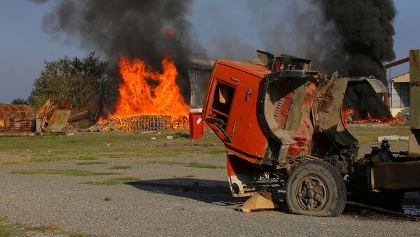 Пожар на заводе после обстрела ВС Армении в Тертере - Sputnik Азербайджан