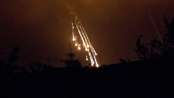 Фосфорные зажигательные снаряды, фото из архива - Sputnik Азербайджан
