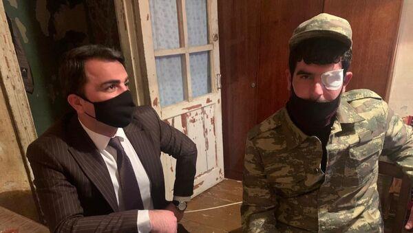 Представитель Минтруда в доме ветерана Эльнура Ханкшиева - Sputnik Азербайджан