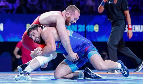 Чемпион мира и Европы Шариф Шарифов и  олимпийский чемпион из США Кайл Снайдер - Sputnik Азербайджан