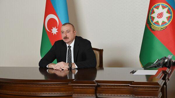 Президент Ильхам Алиев в ходе встречи с делегацией во главе с генеральным секретарем Совета сотрудничества тюркоязычных государств Багдадом Амреевым, прошедшей в видеоформате - Sputnik Азербайджан