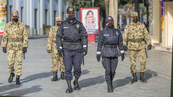 Сотрудники полиции, фото из архива - Sputnik Азербайджан