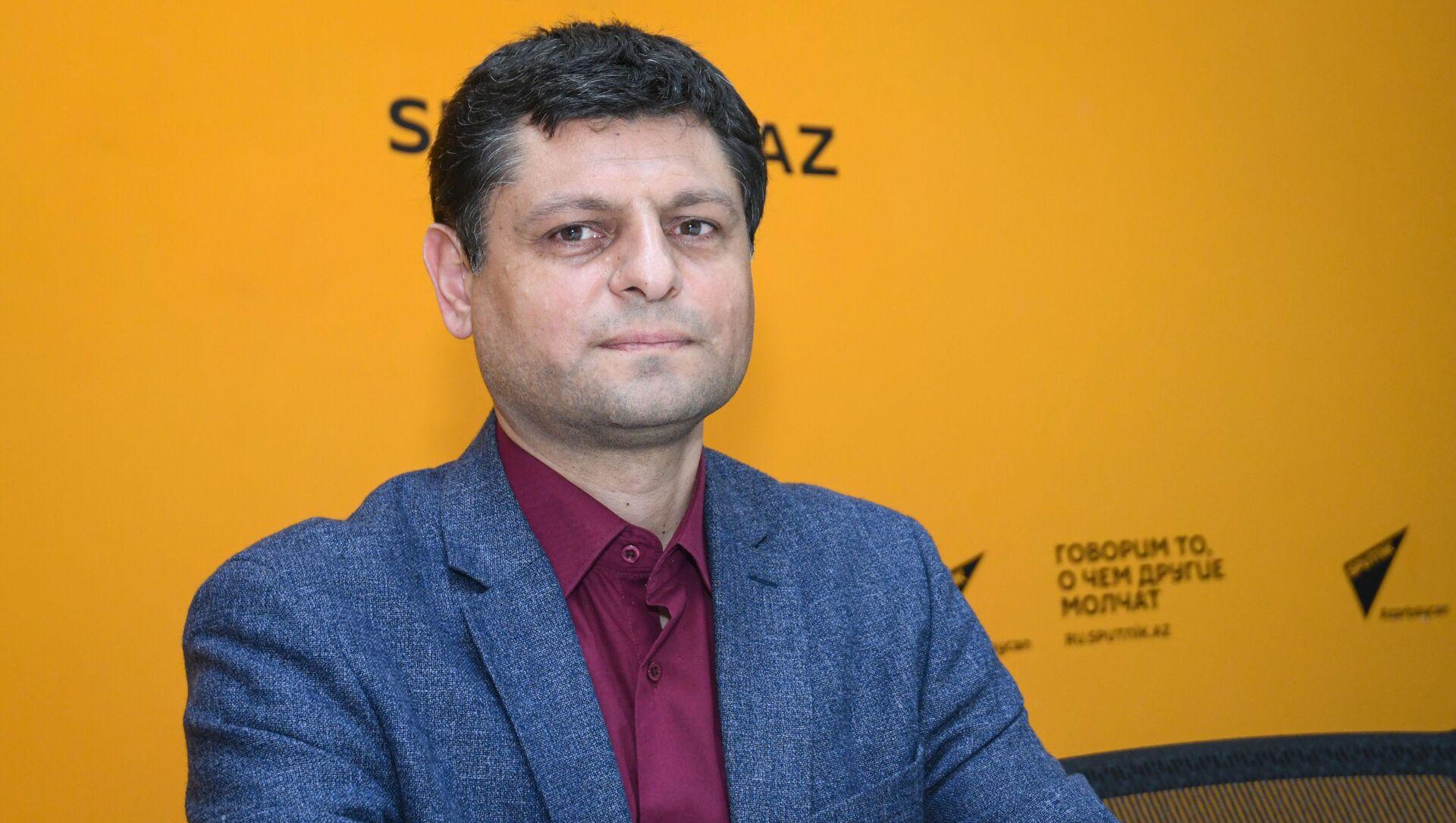 Научный сотрудник Института философии и социологии Национальной Академии Наук Ильхам Аббасов - Sputnik Азербайджан, 1920, 09.04.2021