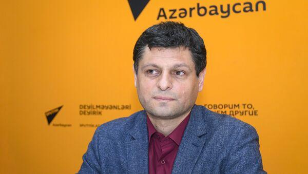Научный сотрудник Института философии и социологии Национальной Академии Наук Ильхам Аббасов - Sputnik Азербайджан