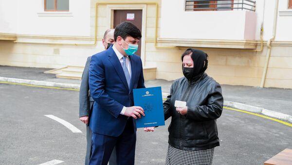 Церемония вручения квартир семьям шехидов  - Sputnik Азербайджан