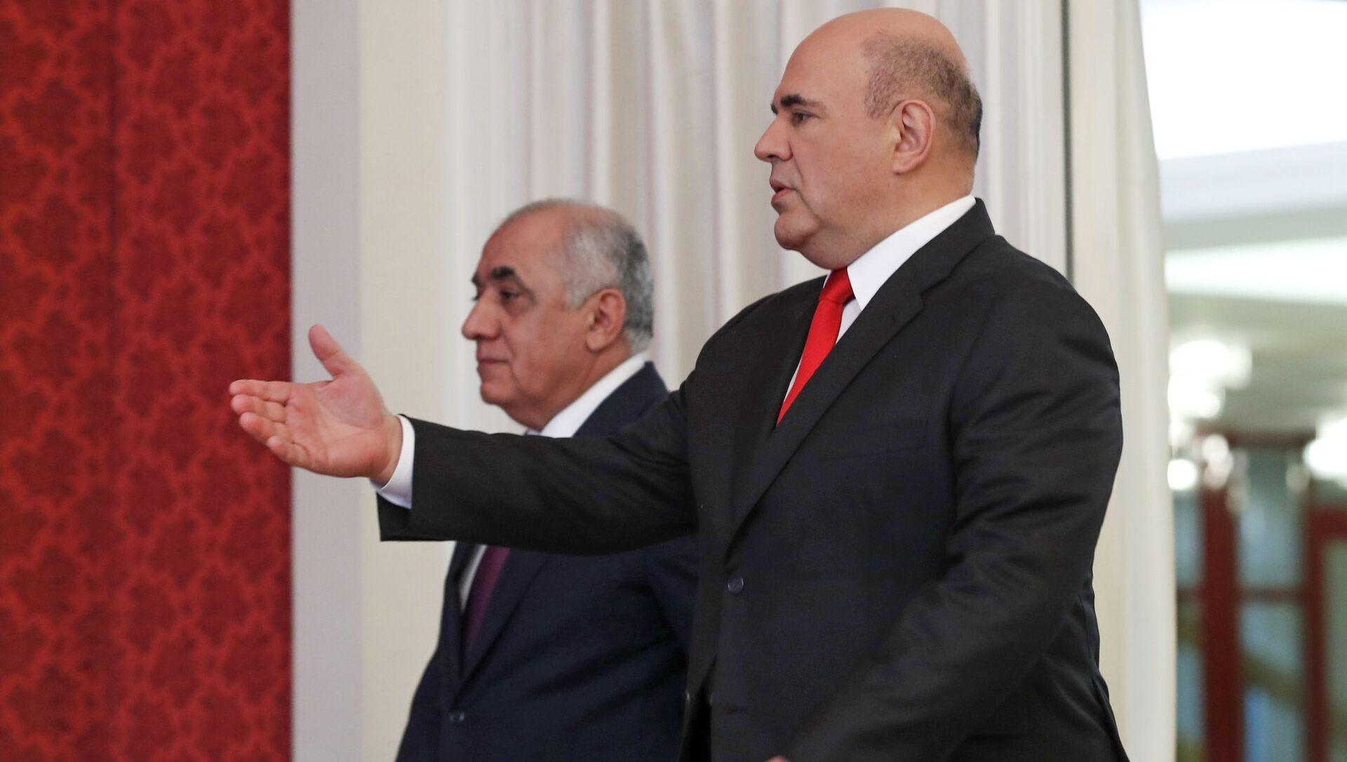 Председатель правительства РФ Михаил Мишустин и премьер-министр Азербайджана Али Асадов (слева) во время встречи, 20 мая 2021 - Sputnik Azərbaycan, 1920, 09.09.2021