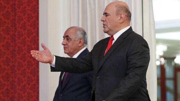 Председатель правительства РФ Михаил Мишустин и премьер-министр Азербайджана Али Асадов (слева) во время встречи, 20 мая 2021 - Sputnik Азербайджан