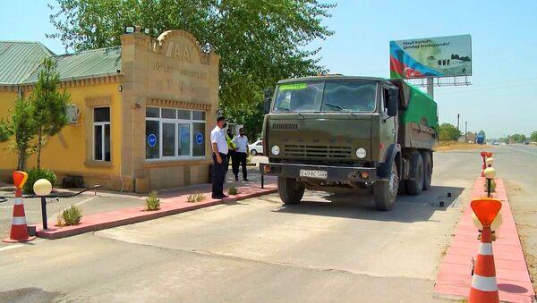 Мероприятия по выявлению грузоперевозчиков, нарушающих допустимые нормы к перевозке груза - Sputnik Азербайджан