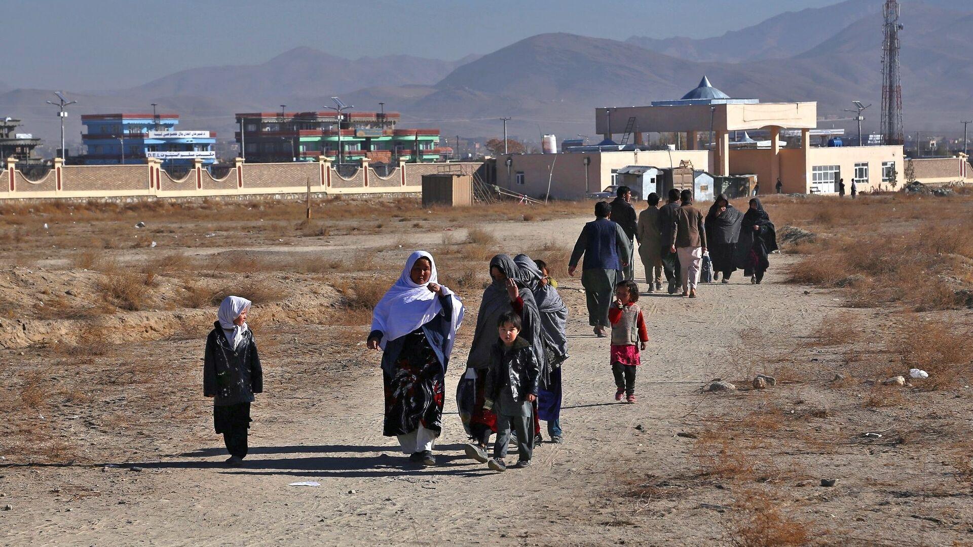 Беженцы из провинции Газни в Афганистане - Sputnik Азербайджан, 1920, 24.08.2021