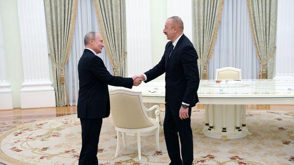 Президент Азербайджана Ильхам Алиев и президент России Владимир Путин во время встречи, фото из архива - Sputnik Азербайджан