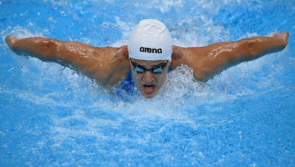 Азербайджанская спортсменка Марьям Шейхализадехангах в заплыве на 100 метров баттерфляем среди женщин во время Олимпийских игр в Токио-2020 - Sputnik Азербайджан