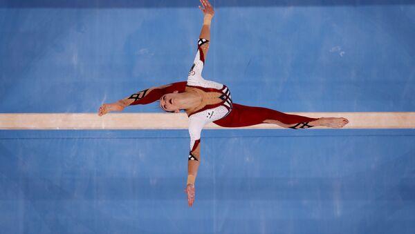 Немецкая спортсменка Паулина Шефер во время квалификационных соревнований по спортивной гимнастике среди женщин на летних Олимпийских играх в Токио - Sputnik Азербайджан