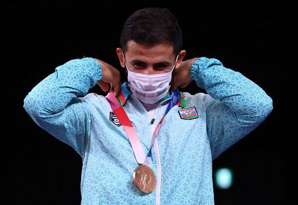 Азербайджанский борец по греко-римской борьбе Рафиг Гусейнов на Олимпийских играх в Токио - Sputnik Азербайджан
