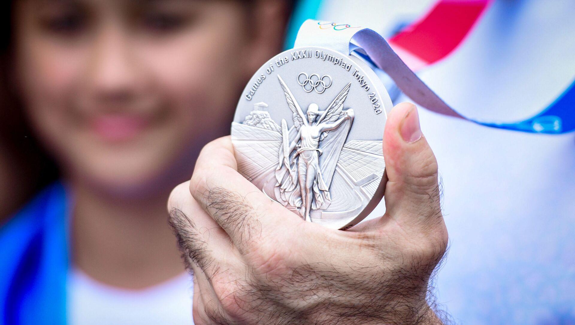 Встреча серебряного призера Олимпийских игр Токио-2020 Рафаэля Агаева в аэропорту Гейдара Алиева - Sputnik Азербайджан, 1920, 12.08.2021