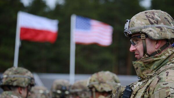 Церемония приветствия многонационального батальона НАТО под руководством США в польском Ожише. - Sputnik Azərbaycan