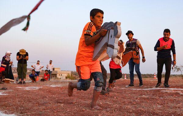 Uşaqlar Suriyada qaçqınlar düşərgəsində Olimpiya Oyunları oynayırlar. - Sputnik Azərbaycan