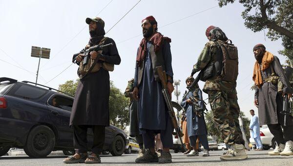 Боевики движения Талибан (террористическая группировка, запрещеннфая в РФ) в Кабуле, 18 авгутса 2021 года - Sputnik Азербайджан