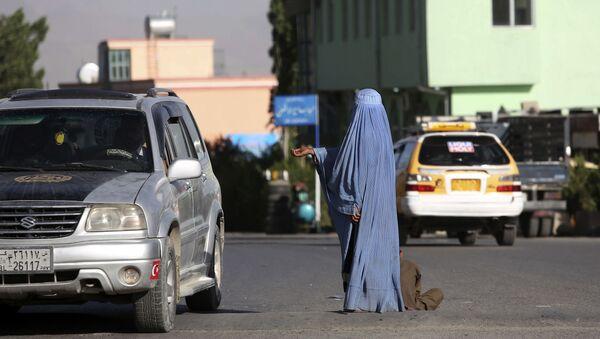 Афганская женщина в Кабуле, фото из архива - Sputnik Azərbaycan