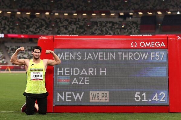 Легкоатлет Гамид Гейдарли установил мировой рекорд в Токио в метании копья - 51 метр 42 сантиметра, завоевав золото Паралимпийских игр Токио-2020. - Sputnik Азербайджан