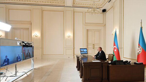 Президент Азербайджана Ильхам Алиев во вторник принял в формате видеосвязи новых глав исполнительной власти Шамкирского и Джалилабадского районов - Sputnik Азербайджан