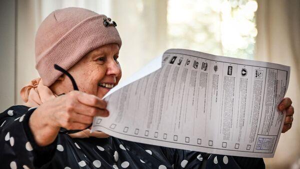 Выборы депутатов Госдумы, законодательных органов и глав субъектов федерации в России  - Sputnik Azərbaycan