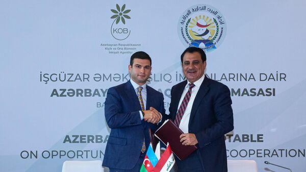 Председатель правления KOBIA Орхан Мамедов и президент Федерации торговых палат Ирака Абдулразак аль-Зухири - Sputnik Азербайджан