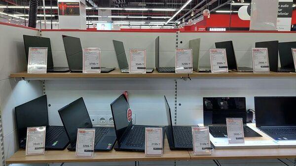 Elektron malların satışı mağazasında - Sputnik Azərbaycan