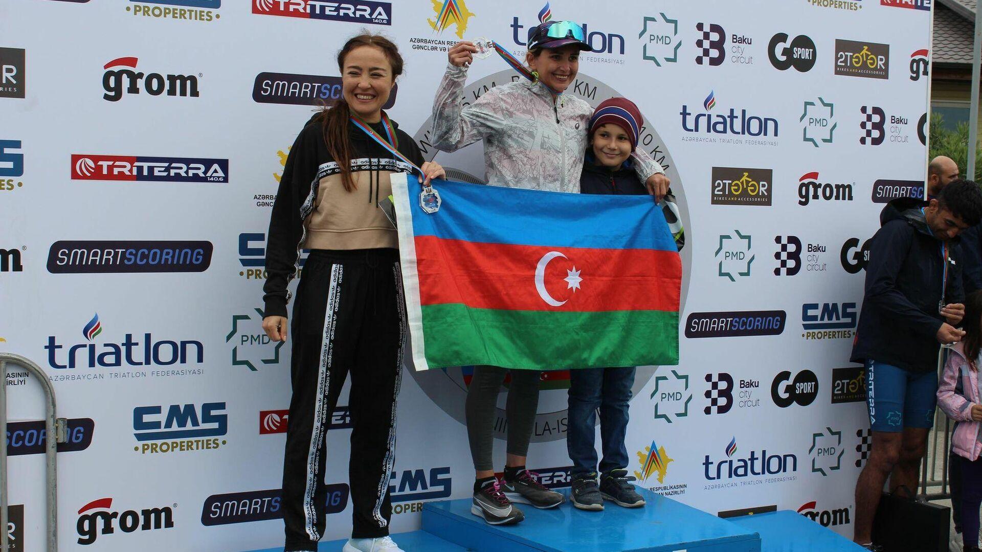 Победители турнира по триатлону IronWinD  - Sputnik Азербайджан, 1920, 11.10.2021