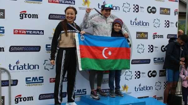 Победители турнира по триатлону IronWinD  - Sputnik Азербайджан