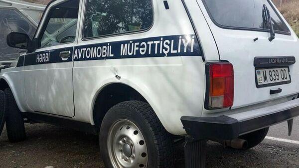 Поврежденный в результате обстрела армянскими вооруженными формированиями автомобиль - Sputnik Азербайджан