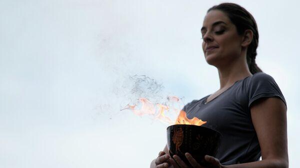Олимпийский огонь зимних Игр-2022 в Пекине зажжен в Древней Олимпии - Sputnik Азербайджан