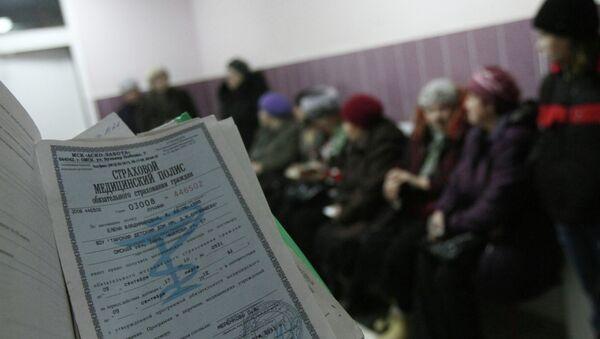 Страховой полис, фото из архива - Sputnik Азербайджан