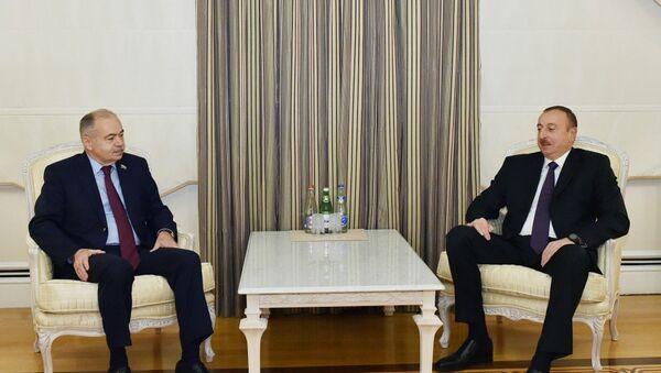 Президент Ильхам Алиев на встрече с заместителем председателя Совета федерации РФ Ильясом Умахановым - Sputnik Азербайджан