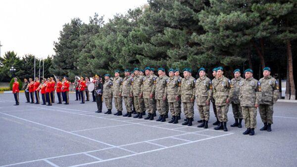 Группа азербайджанских миротворцев вернулась в Азербайджан из Афганистана - Sputnik Азербайджан