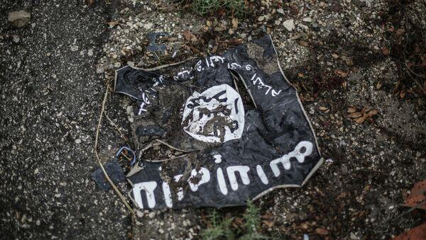 The flag of the radical Islamist organization Islamic State of Iraq - Sputnik Азербайджан