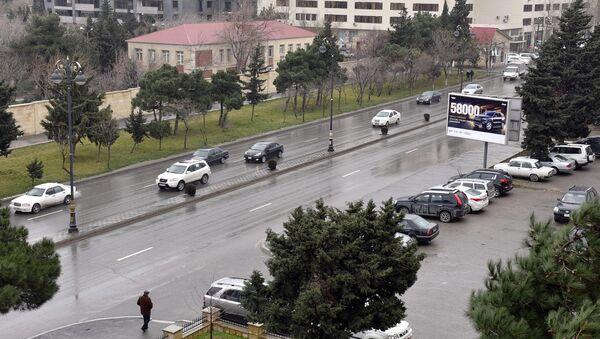 Мокрый снег в Баку, архивное фото - Sputnik Азербайджан